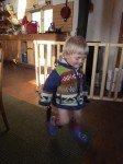"""Tim est tout exité d'essayer ses nouvelles bottes, """"papillon violet"""" (son premier choix vestimentaire)"""